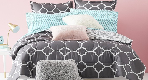 grey with white geographic print comforter on bed with matching pillow cases and shams