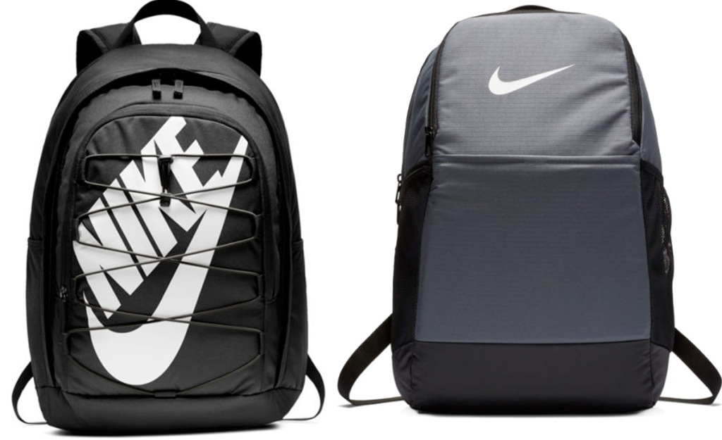 two black and grey nike backpacks with nike logo in white on front