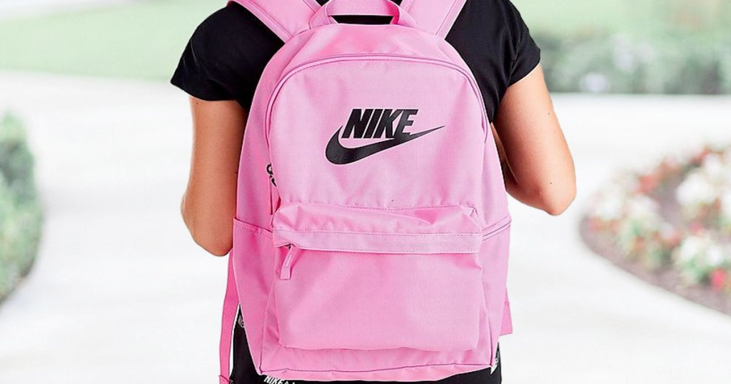 girl wearing black shirt and pink nike backpack with black nike logo