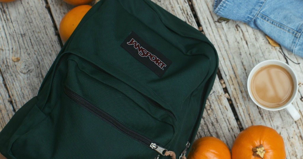 backpack by pumpkins and coffee