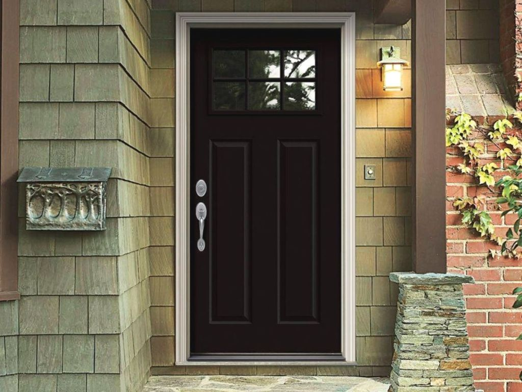A front porch with a black door