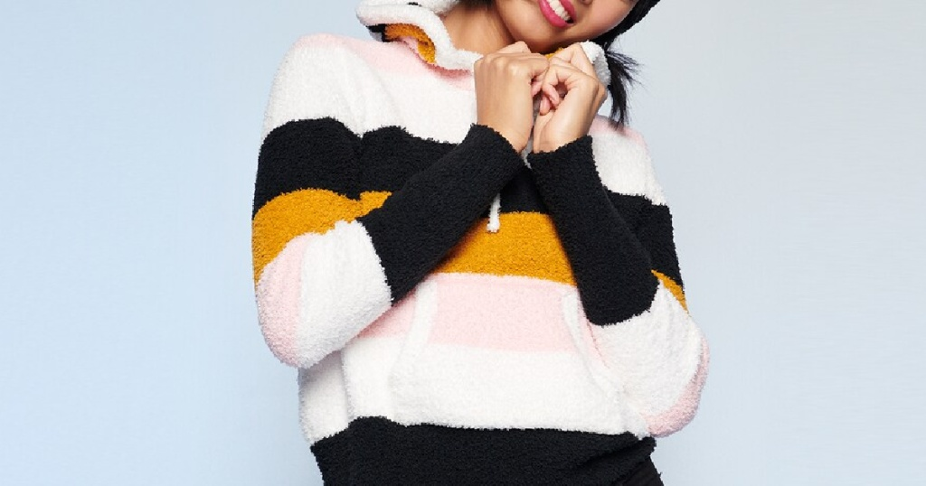 woman in blue, white, yellow, and pink striped hooded sweater