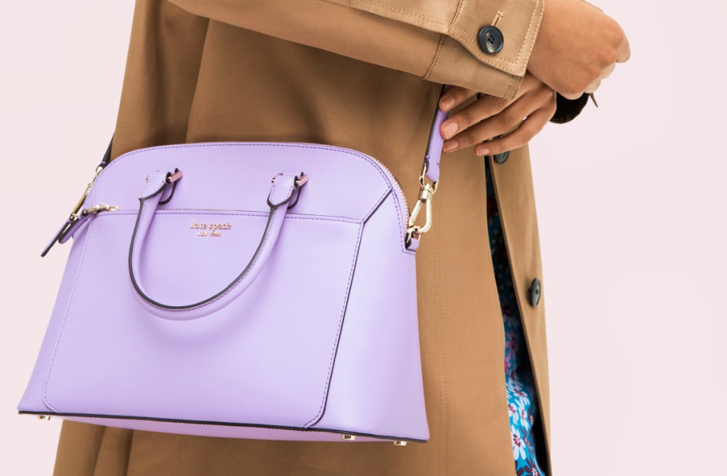 woman holding a Kate Spade Louise Medium Dome Satchel
