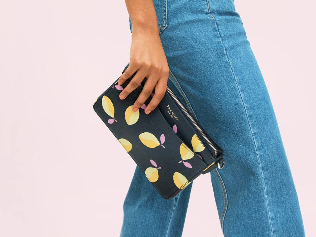 woman holding a Kate Spade Margaux Lemons Medium Convertible Crossbody