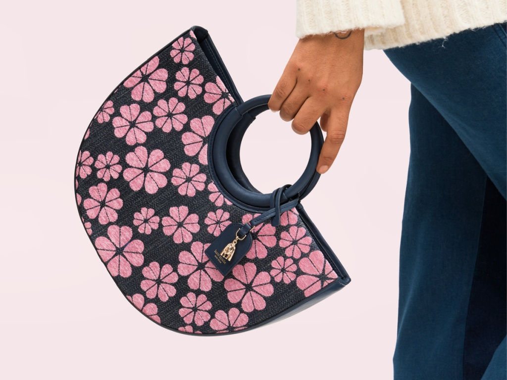 woman holding a Kate Spade On Purpose Circle Tote