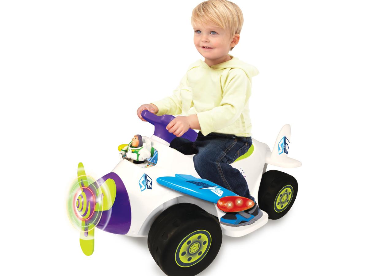 little boy riding on buzz light year ride on vehicle
