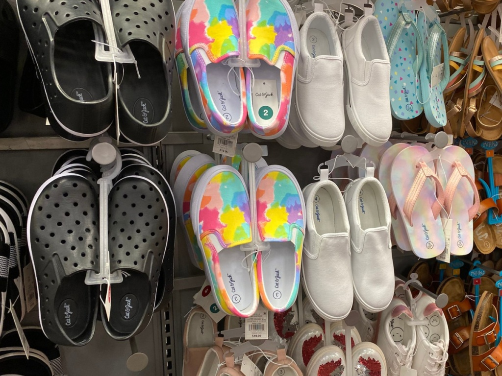 boys and girls shoes hanging on a rack in-store at target