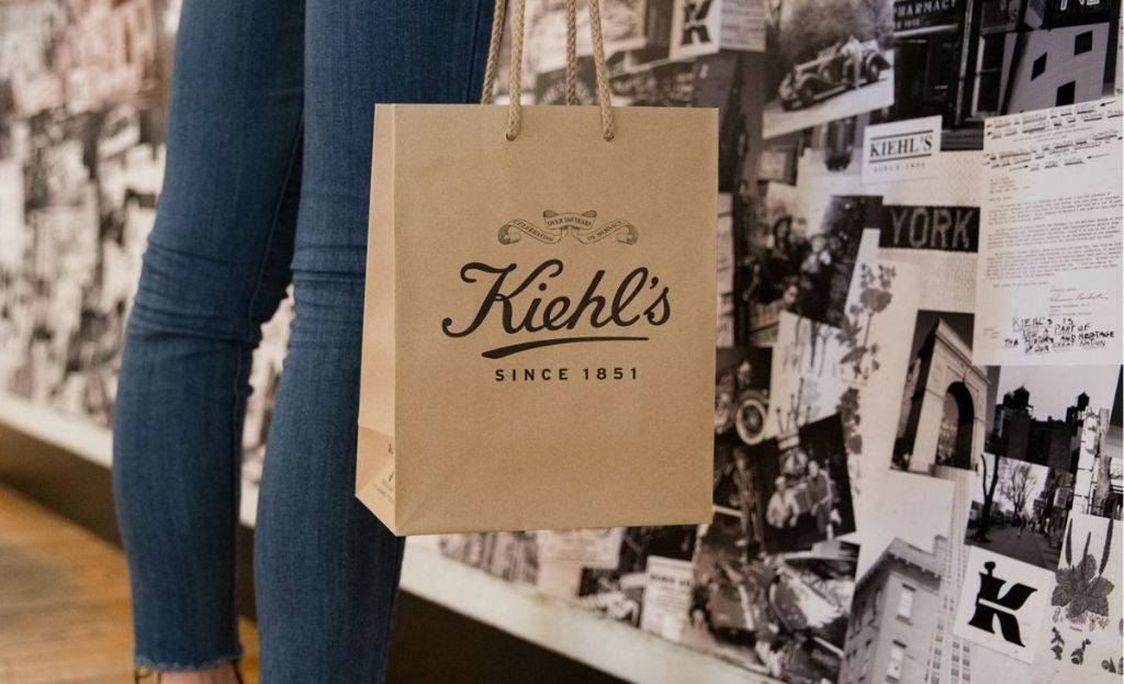 Someone holding a Kiehl's shopping bag