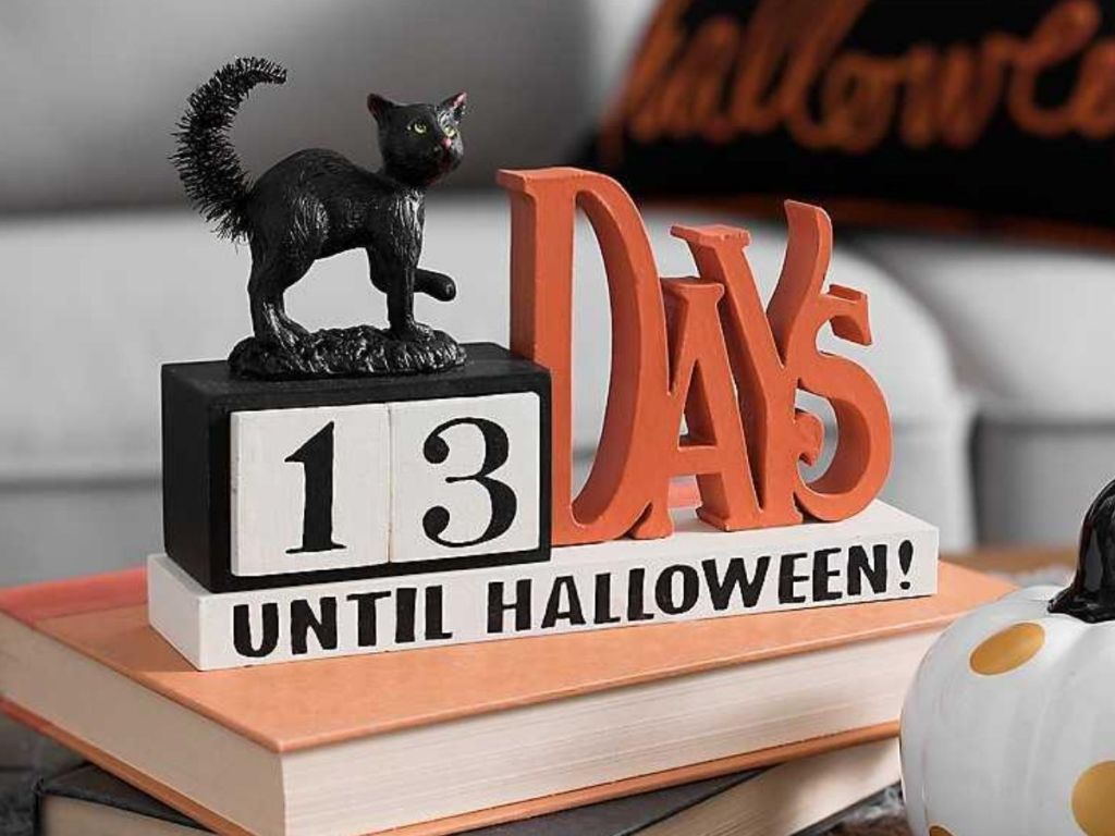 halloween countdown calendar with black cat on it