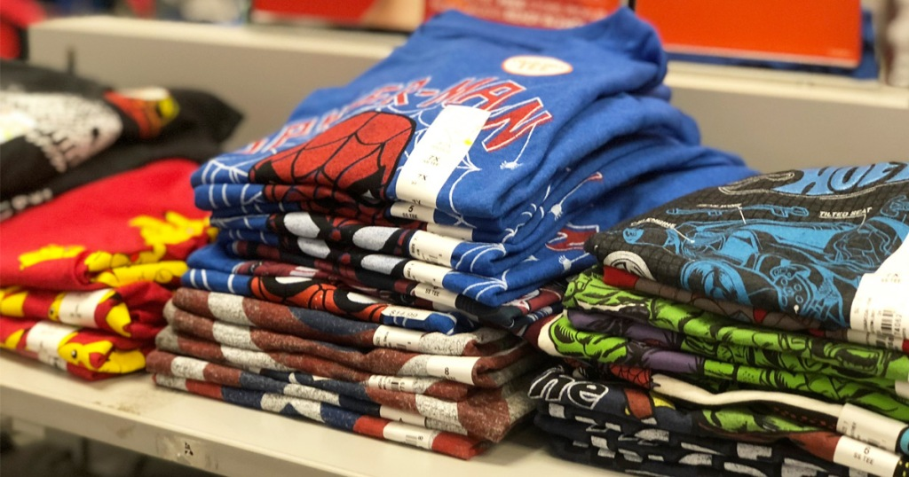 store display shelf filled with folded boys graphic tees
