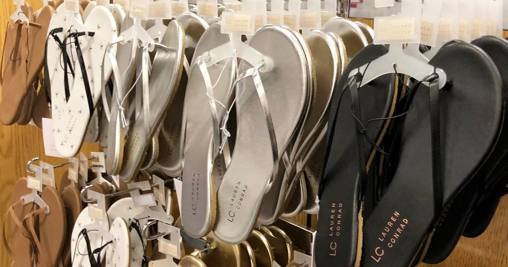 womens flip flops of various colors hanging on store display