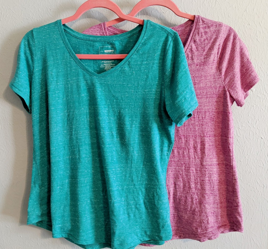 turquoise and pink women's v-neck tees on pink hangers