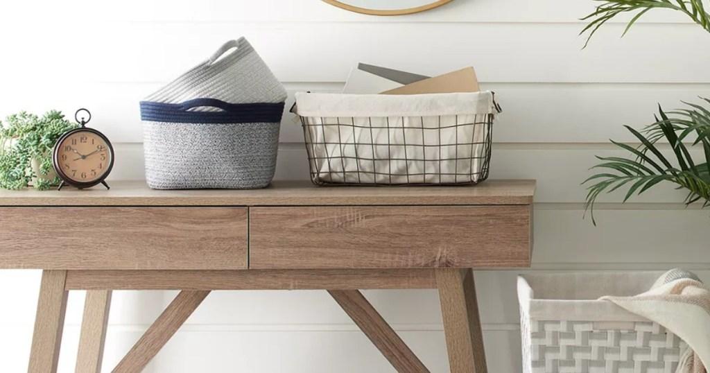 Storage bins and baskets on desk