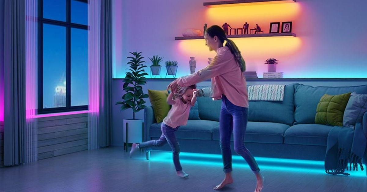 woman and child dancing in living room