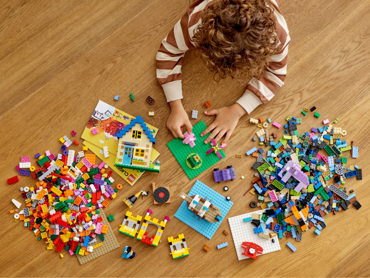 child playing with LEGO set on floor