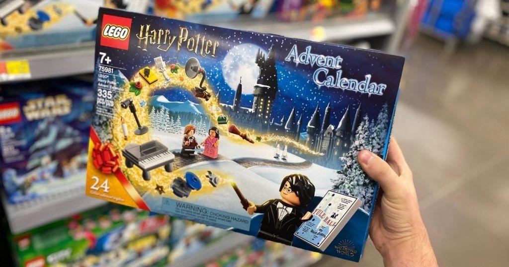 hand holding a LEGO Harry Potter Advent Calendar