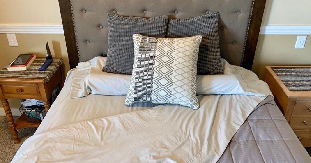 light gray sheets and pillows on bed