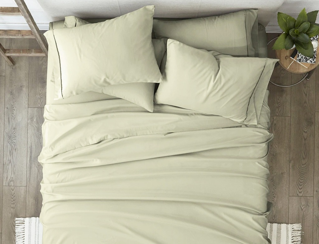 cream colored sheet set on bed with matching pillow cases