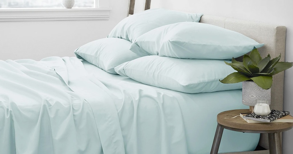 light blue sheet set on bed with matching pillow cases