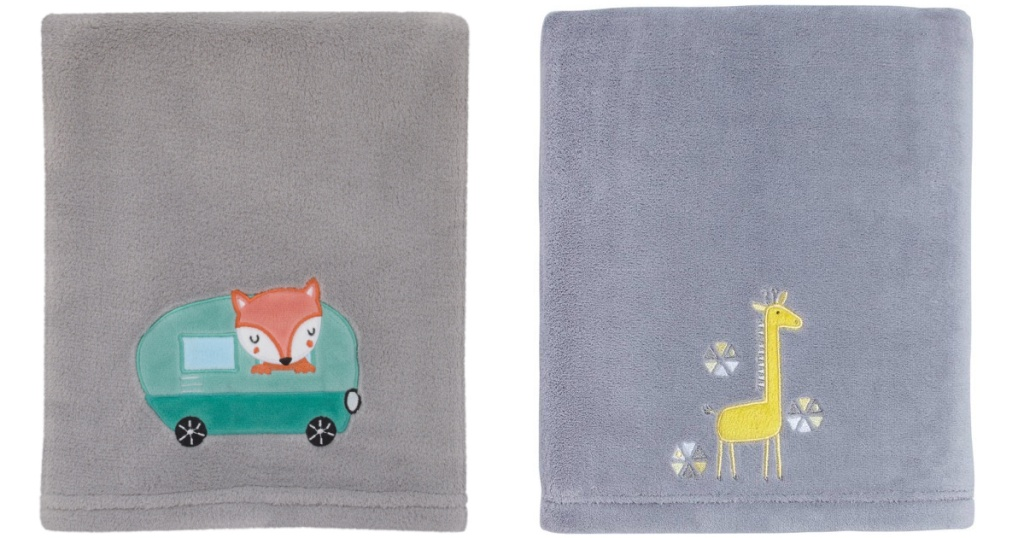 two light grey baby blankets sitting side by side