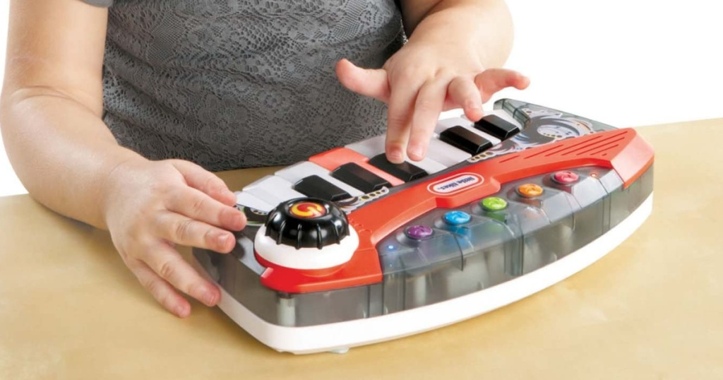 small child tapping on a kids keyboard