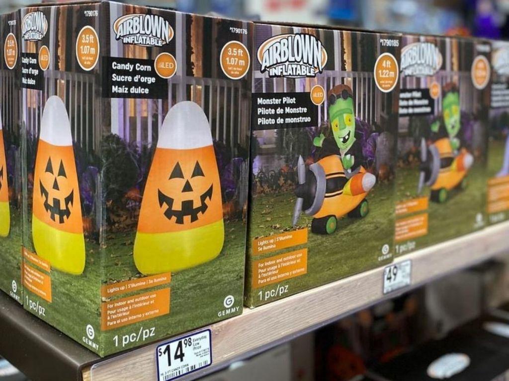 shelf of blow up halloween decorations