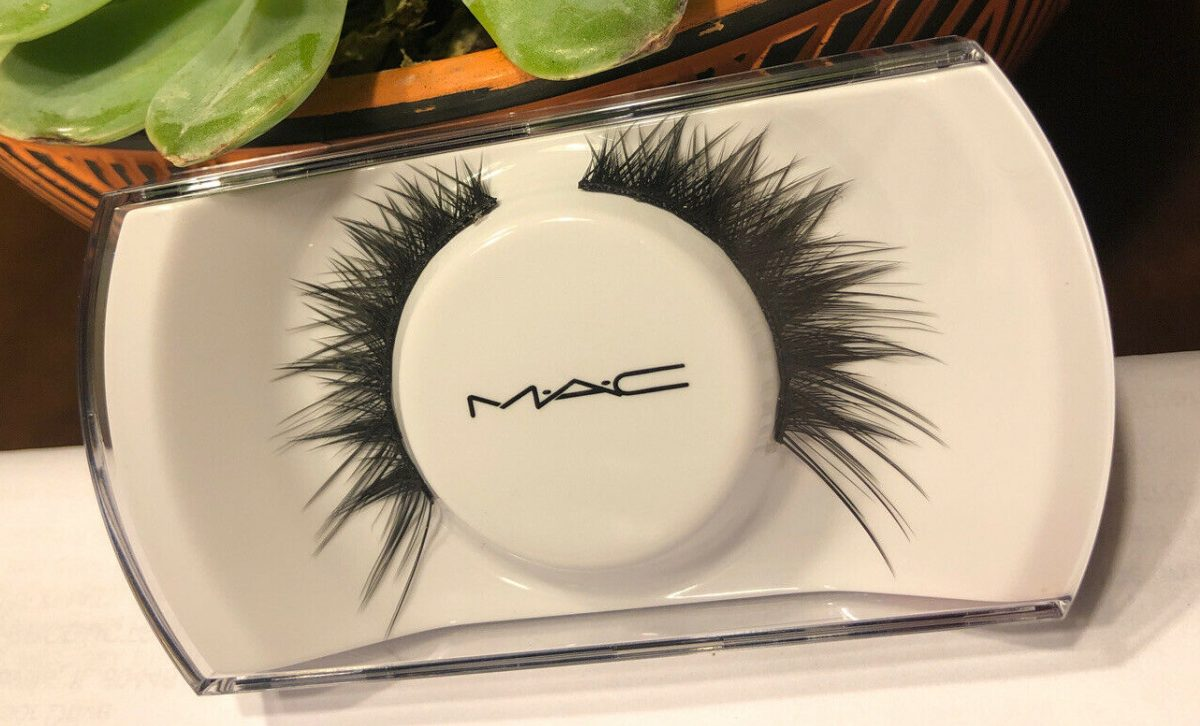 eyelash set on table next to plant