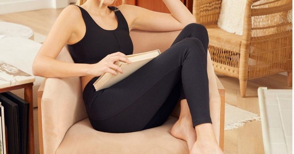 woman sitting in chair wearing leggings