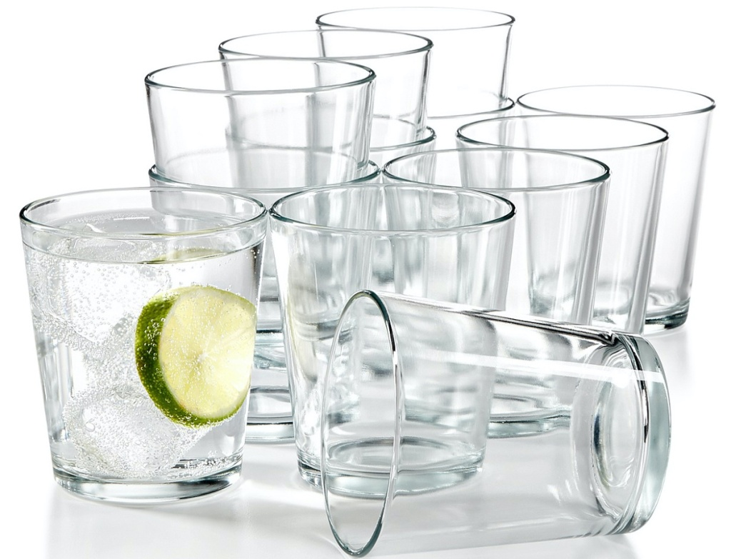 twelve small tumblers, one filled with water and lime