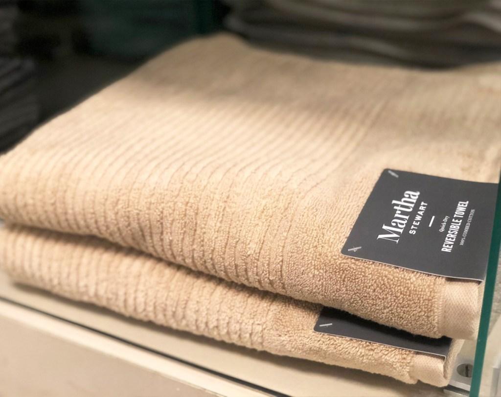 folded brown Martha Stewart quick dry bath towels