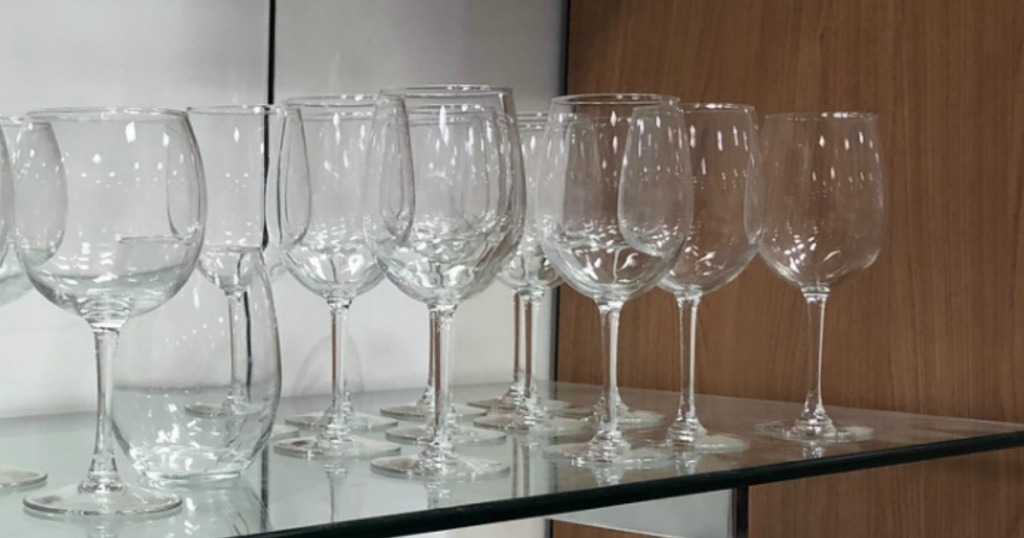 Collection of wine glassware on shelf in-store