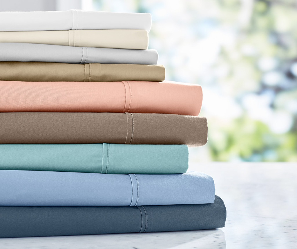 pile of folded sheets in nine different colors