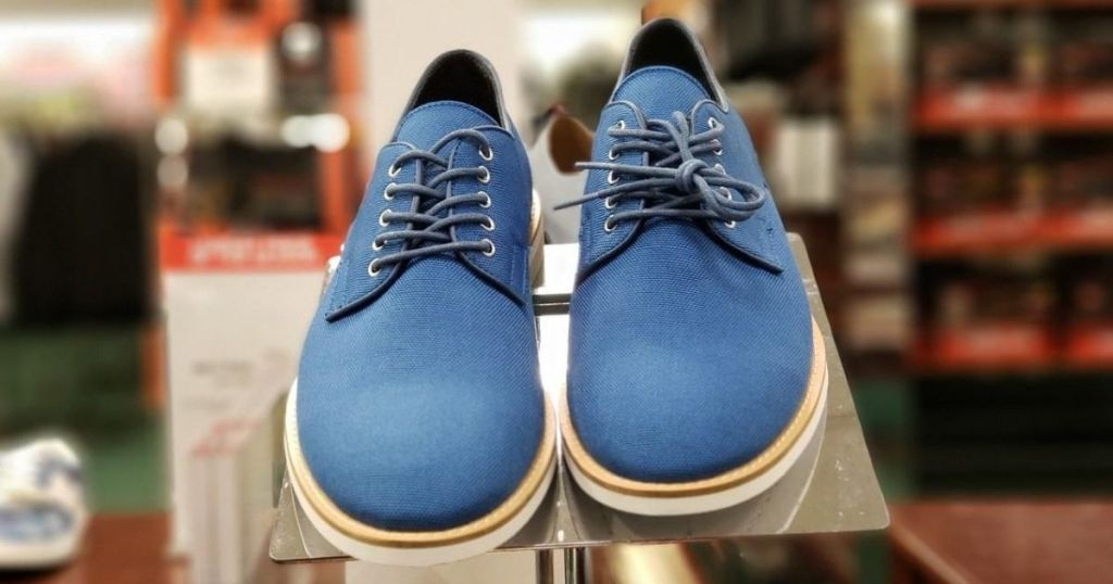 pair of men's blue shoes at store