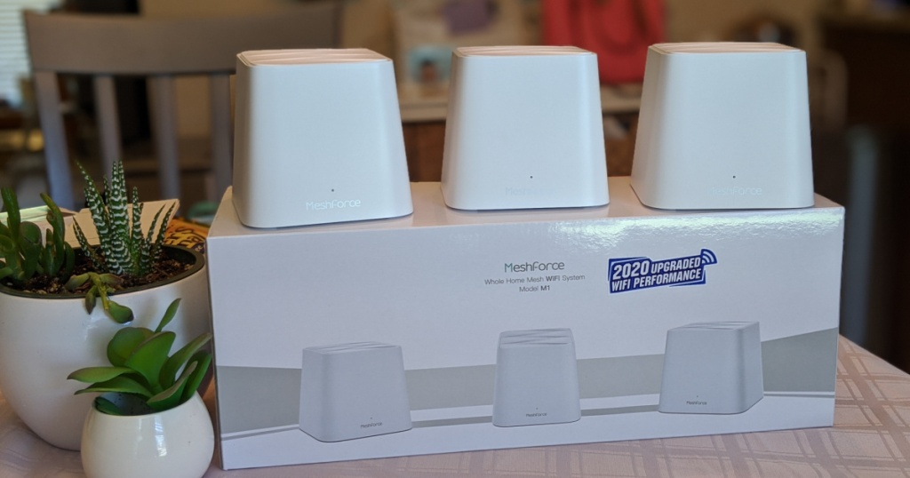 Meshforce Whole Home WiFi System on top of box