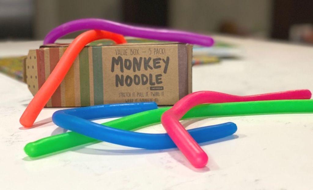 Monkey noodle sensory toys on a counter