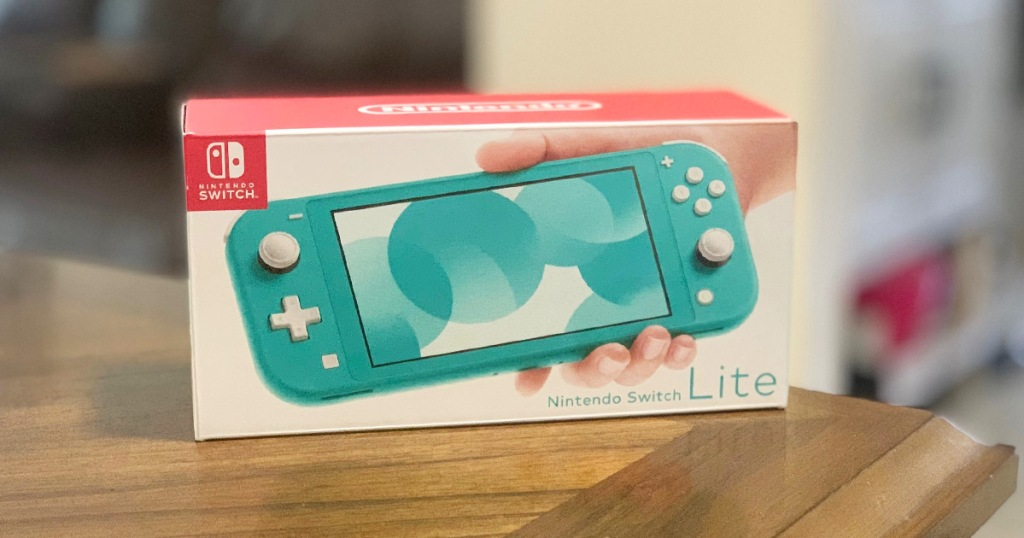 box for a blue nintendo switch lite on a wood table