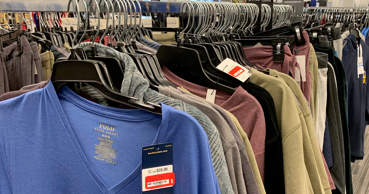 shirts with clearance price tags hanging on hangers on store display rack