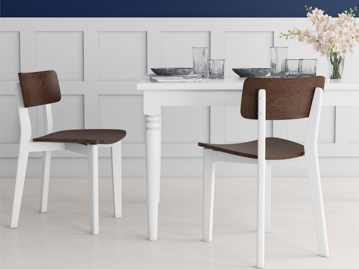 two brown and white chairs at white table in dining room