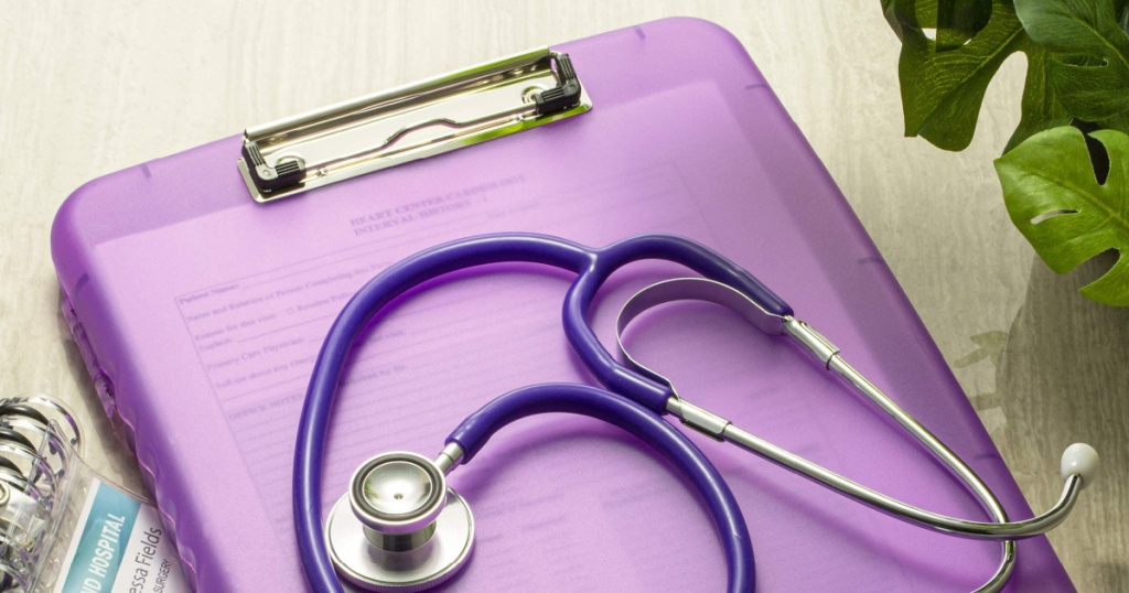 Officemate Purple Slim Clipboard Storage Box w/ Stethoscope sitting on top