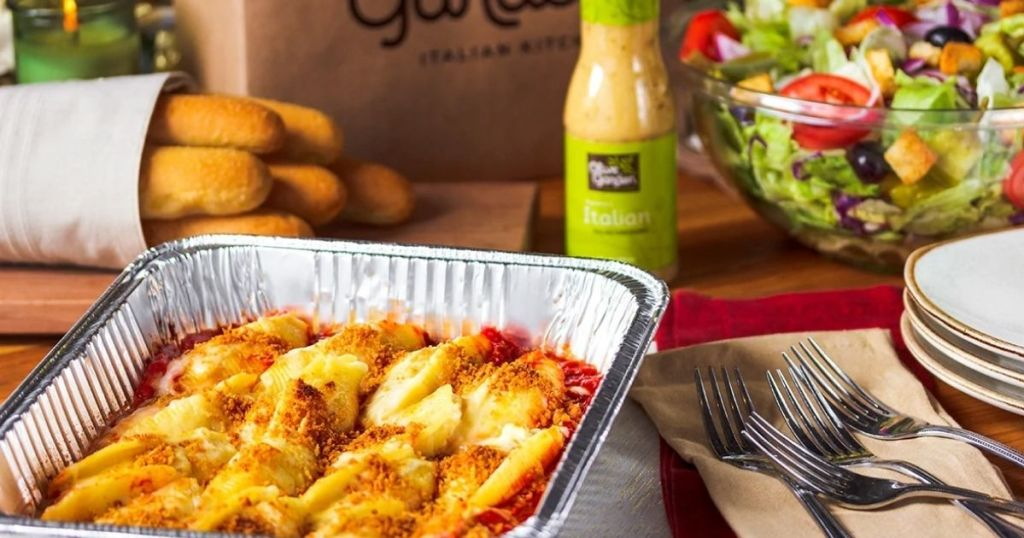Olive Garden Bake at Home stuffed shells with salad dressing and salad