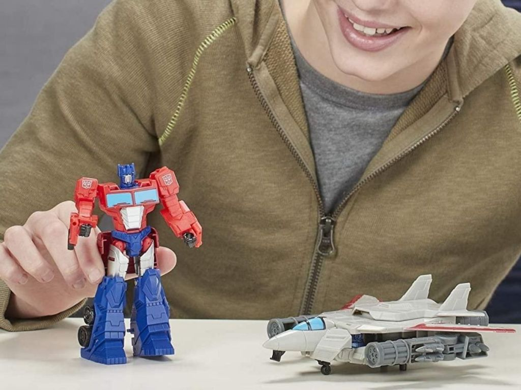 kid playing with transformer toy
