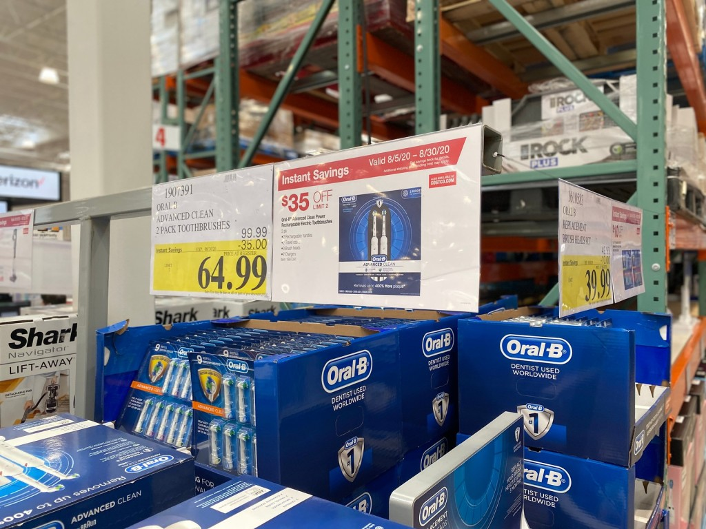 Costco sign showing sale price of toothbrushes