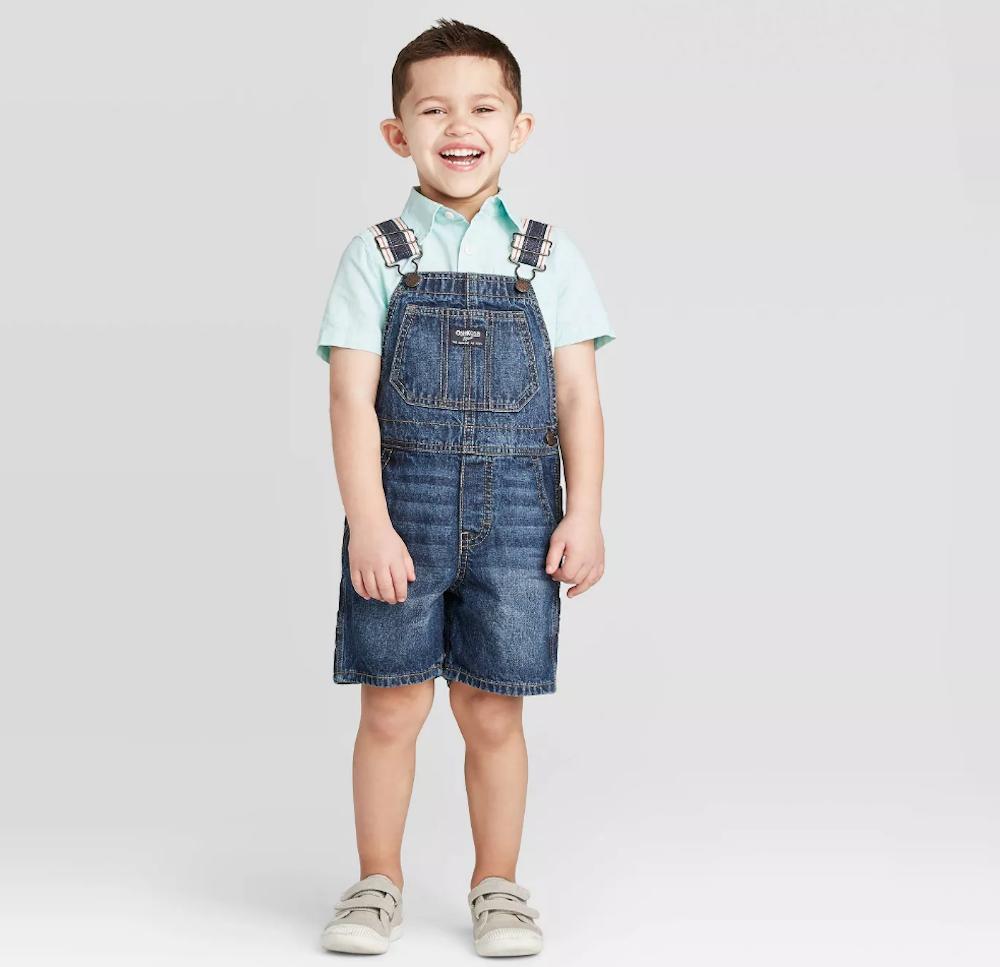 boy wearing OshKosh Overalls