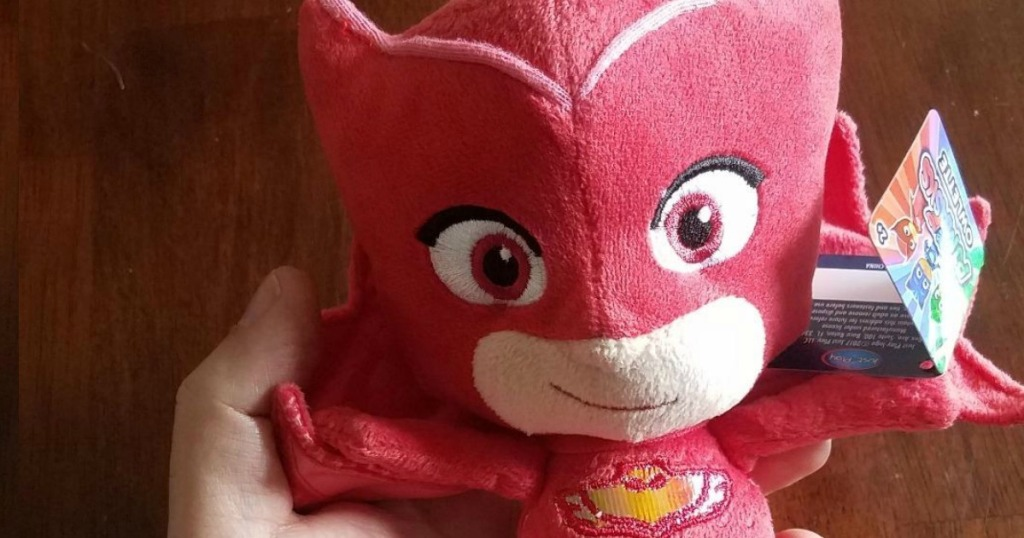 hand holding an Owlette plush toy