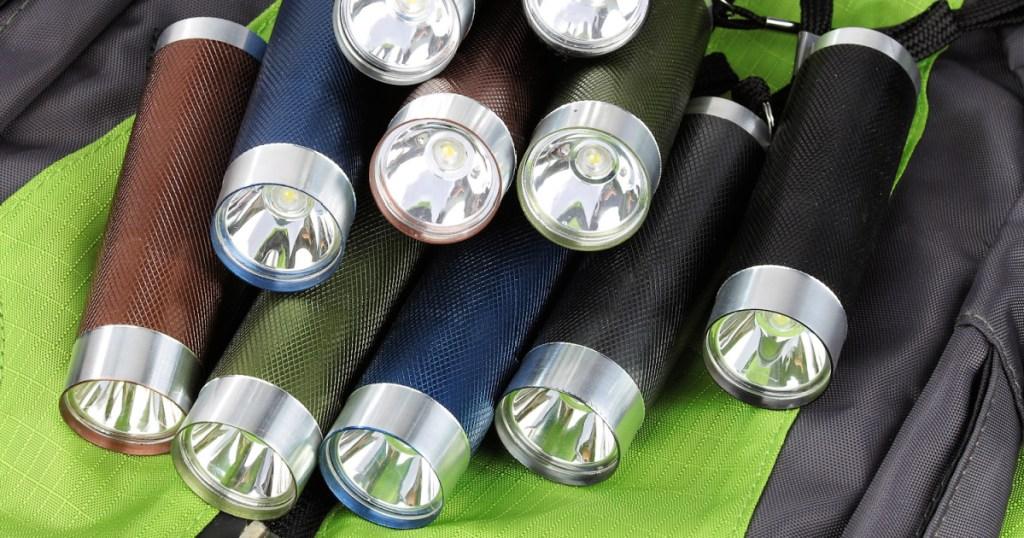 multiple ozark trail flashlights on backpack