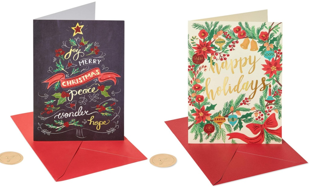 two papyrus holiday cards sitting side by side