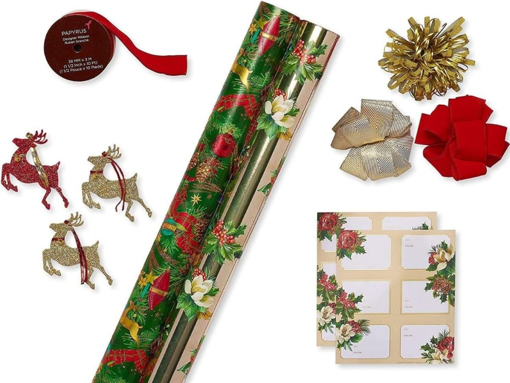 gift wrap kit with two rolls of wrappingpaper, bows, ribbon, tags and reindeer decorations