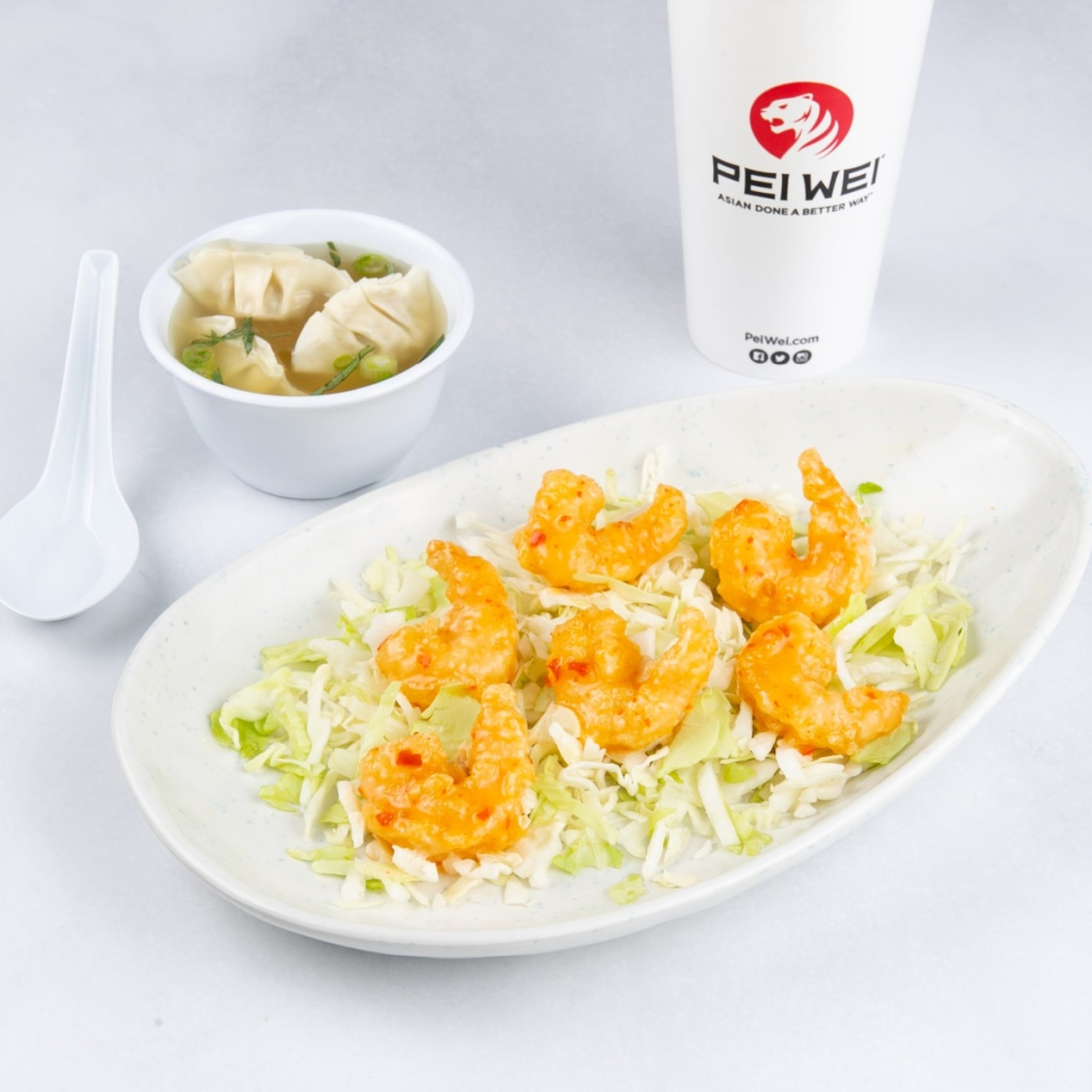 Yum Yum Shrimp in dish on table near drink