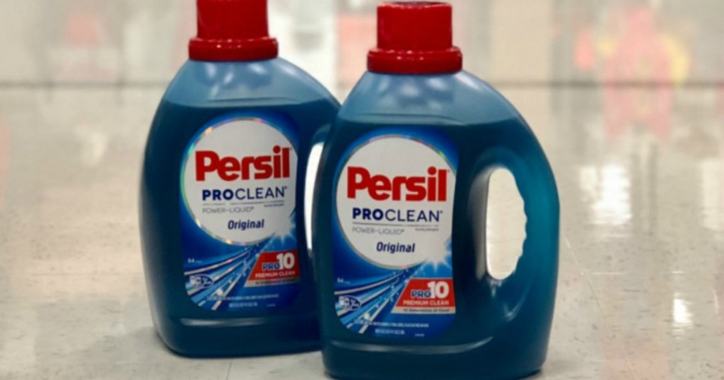 two bottles of persil on floor