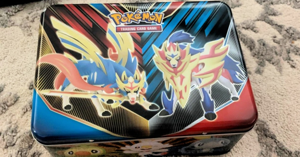 Pokemon Trading Card Game collector's tin on rug